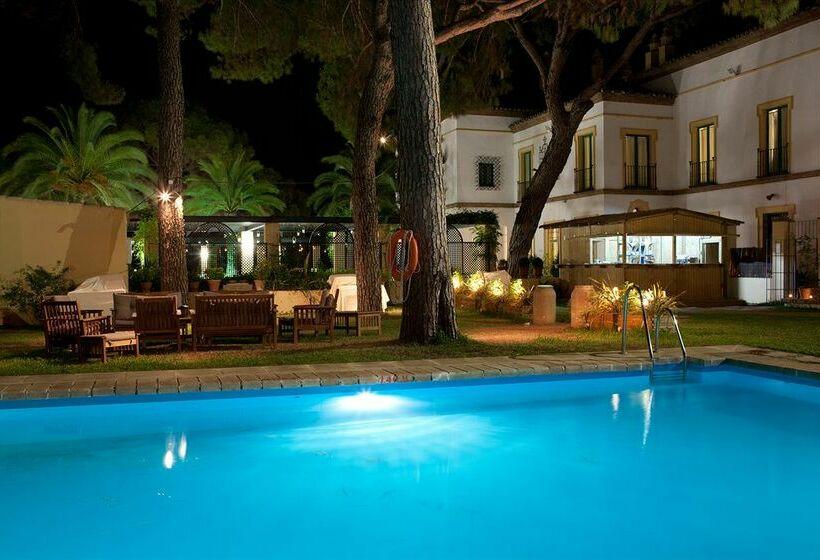 Hotel oromana en alcal de guadaira destinia for Piscina alcala de guadaira